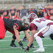 Junior defensive end Brian Khoury lines up opposite the University of Chicago offensive line.