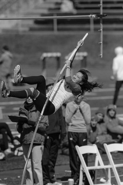 Grace Yee launches herself away from the ground in a pole vaulting event in the 2015 season. (credit: CMU Athletics)