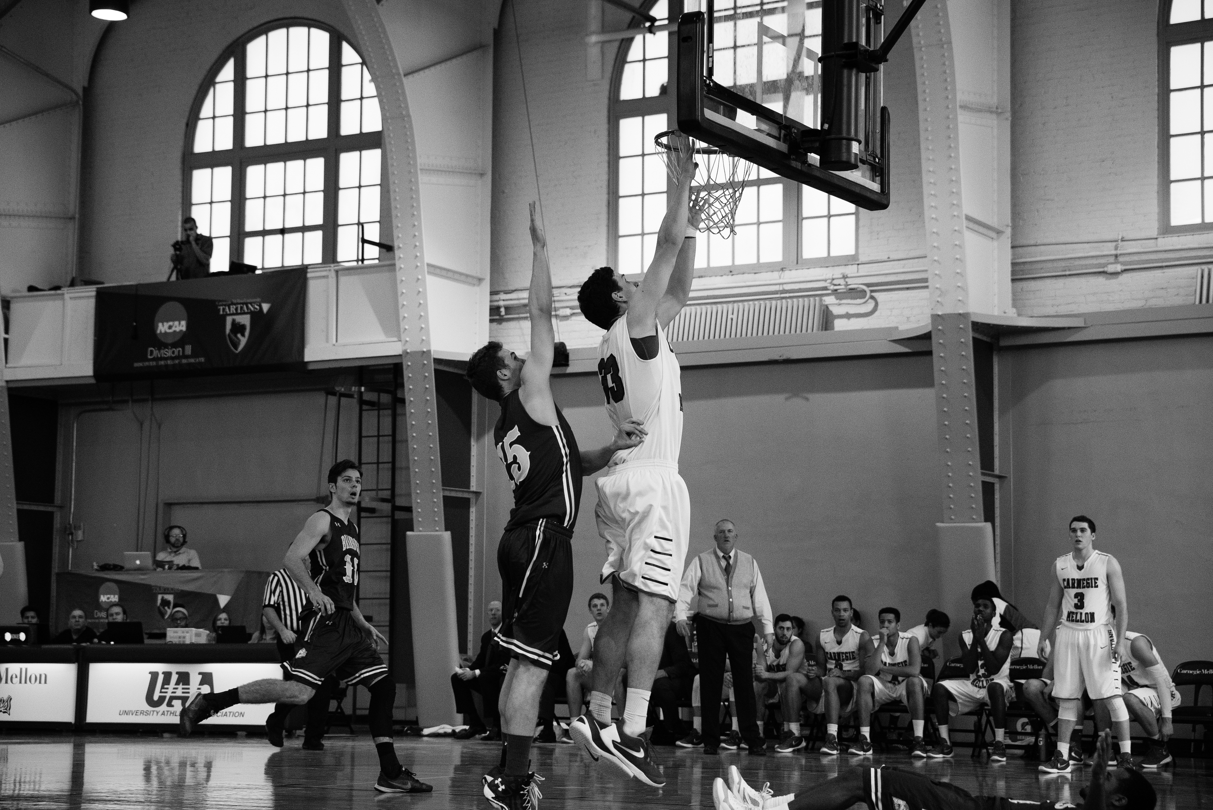 Junior center Chris Shkil beats a Brandeis defender on Saturday to make a lay up for his team and get the win. (credit: Brandon Hong/Photo Editor)