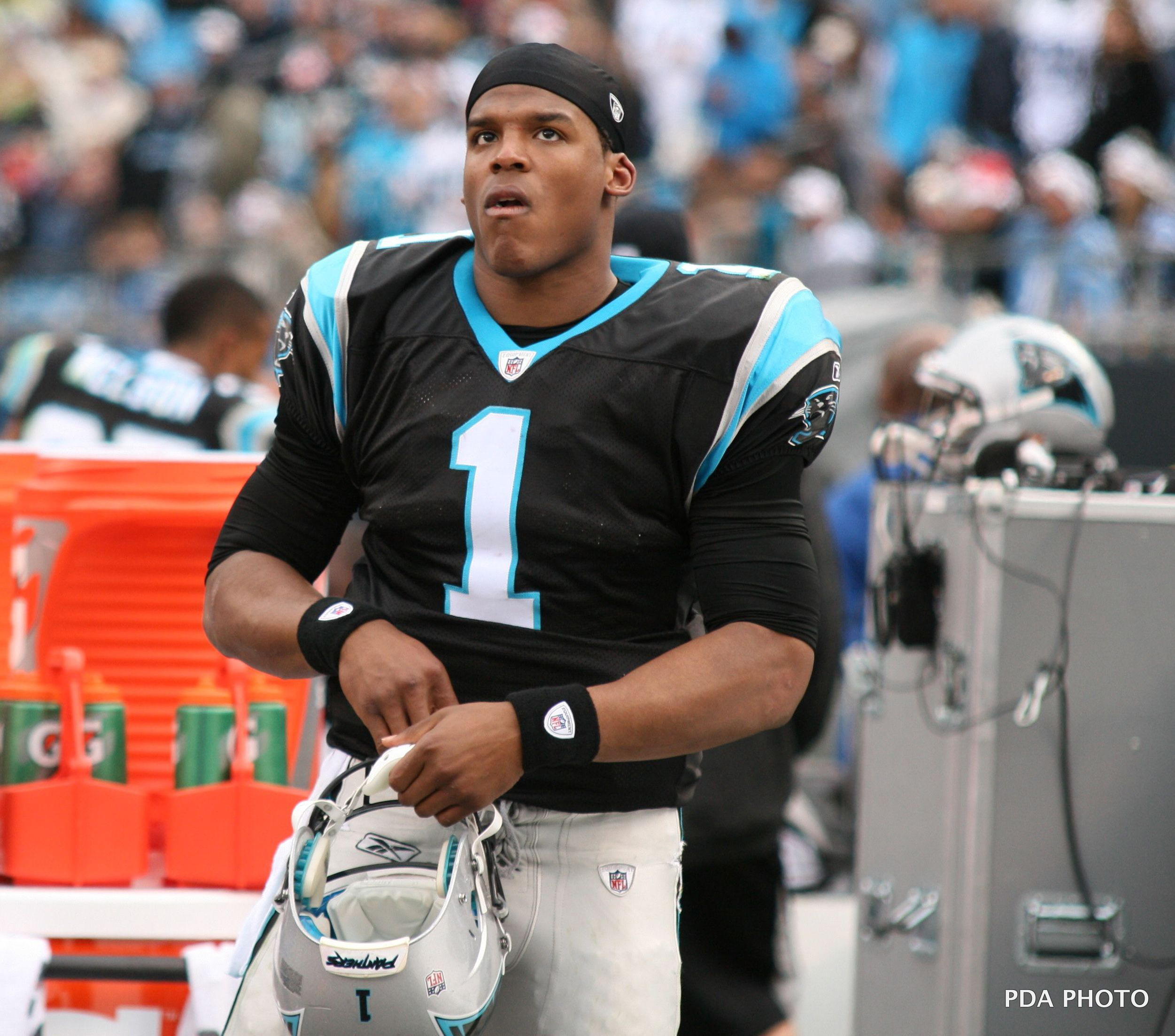 Cam Newton looks out into the crowd with a disgruntled look on his face. (credit: Photo Courtesy of Parker Anderson via Flickr)