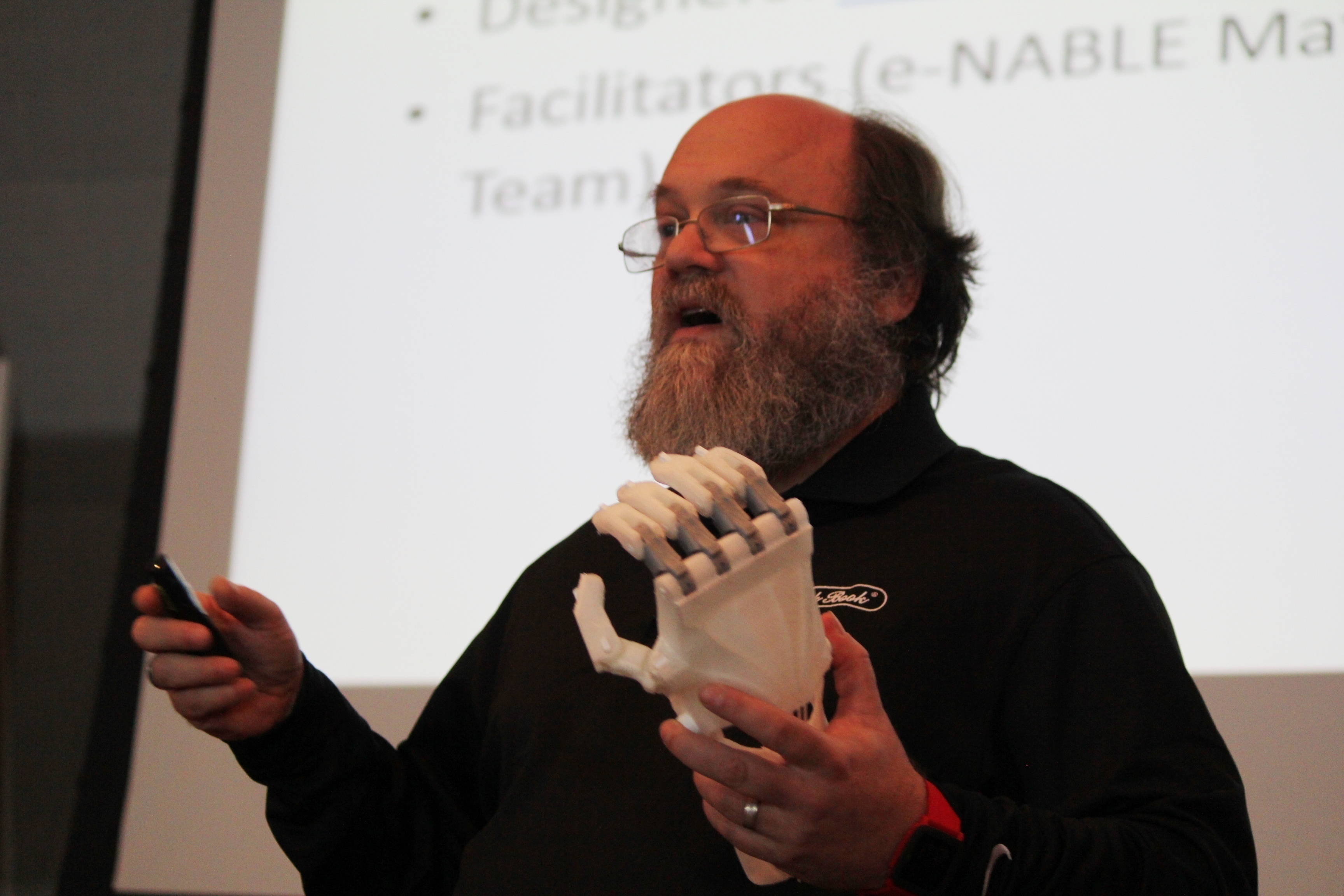 Laird Popkin, developer at e-NABLE, presents a more flexible, durable. and cheaper model of 3-D prosthetic hand at TEDxTampaRiverwalk 2015. (credit: Theresa Willingham via Flickr Creative Commons)