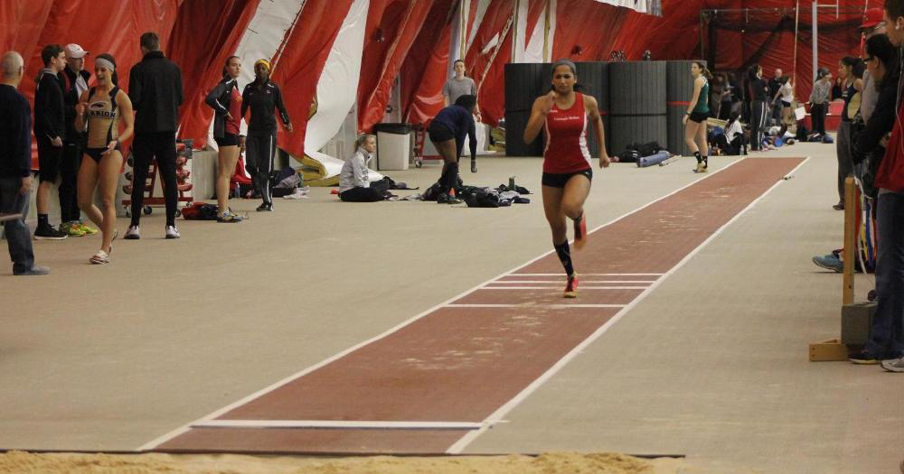 Sprinter and jumper Debarati Bhanja sprints to the jump line during the UAA indoor championships at NYU. (credit: Courtesy of CMU Athletics)