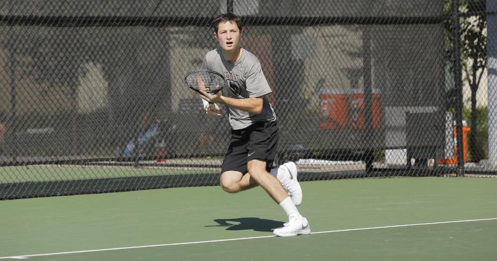 First-year Daniel Levine focuses on the ball during a close tennis match against NCAA Division I opponents. (credit: Courtesy of CMU Athletics)