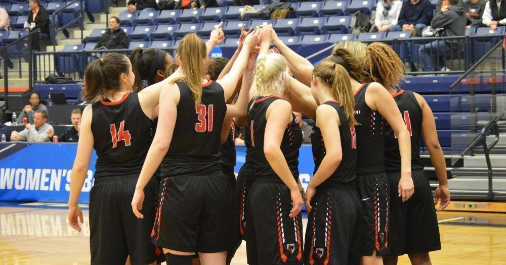 The Carnegie Mellon women's basketball team huddles together in anticipation to prepare for the next game. (credit: Courtesy of CMU Athletics)