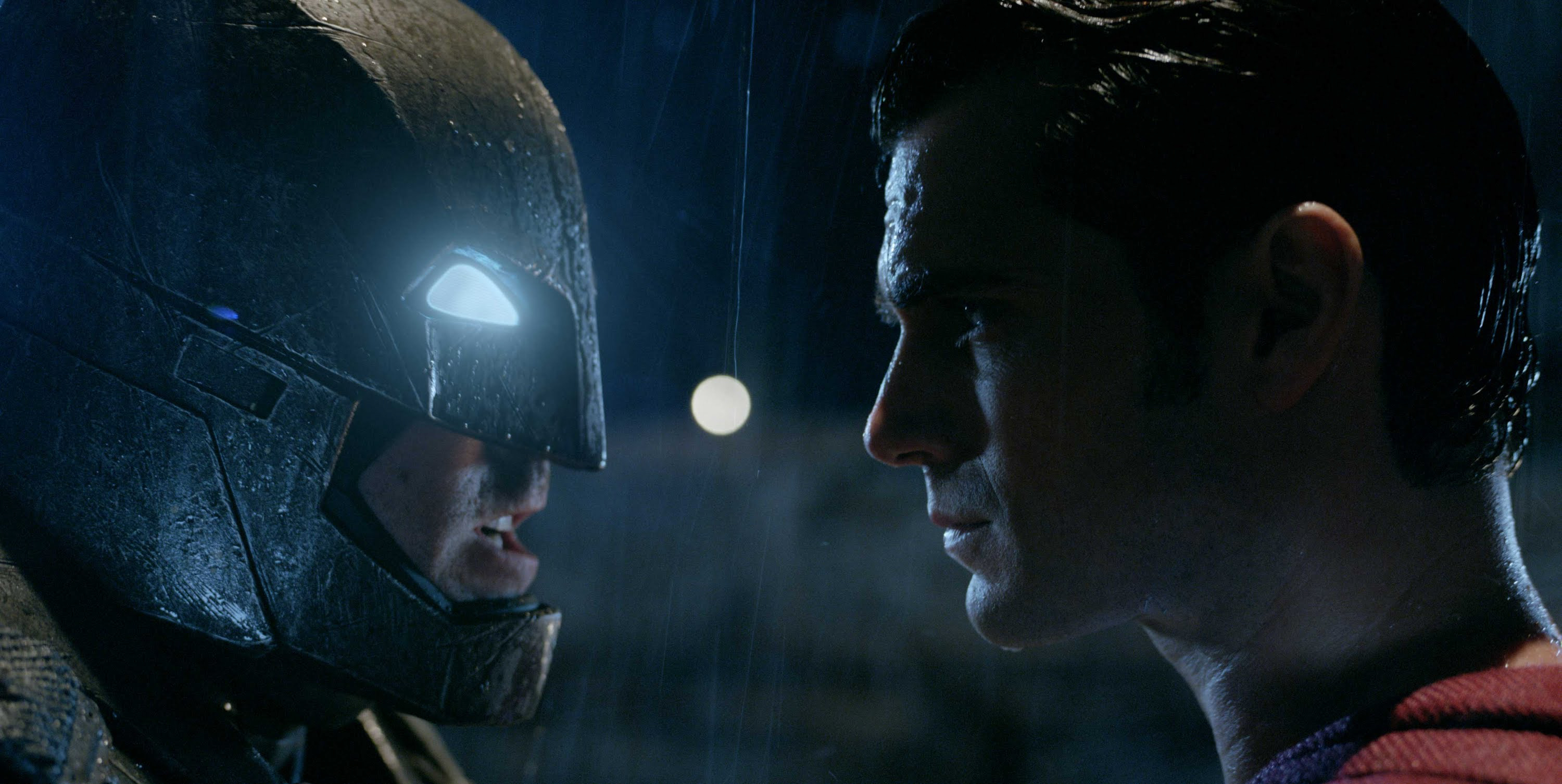Ben Affleck as Batman and Henry Cavill as Superman quite literally face off before battling each other.