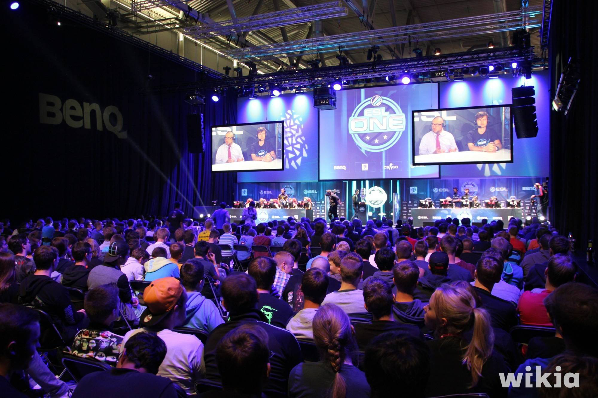 A crowd of fans watches intently for the action at a CS:GO tournament. (credit: Courtesy of Tim Bartel via Flickr Creative Commons)