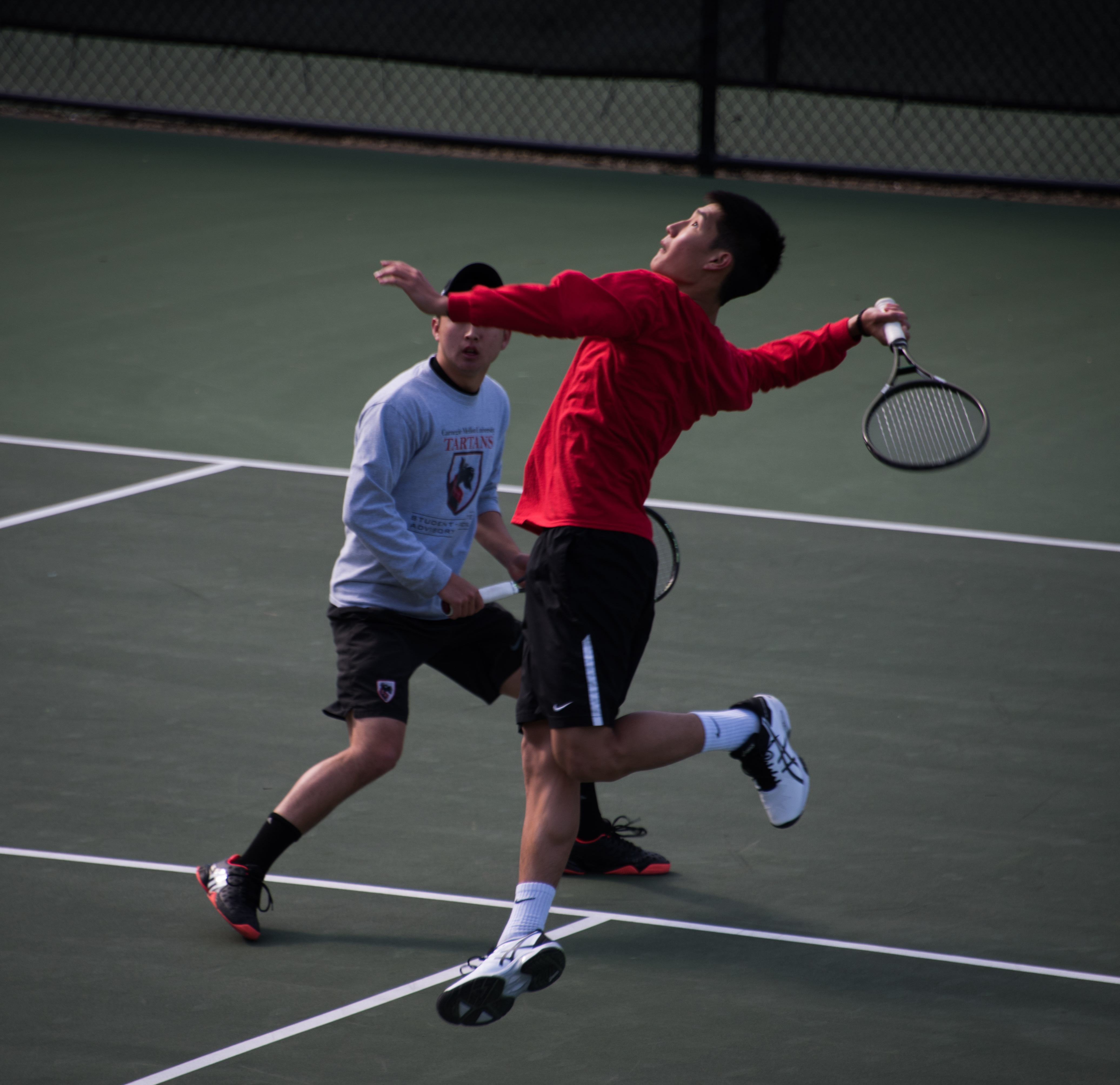 Doubles partners Jeffrey Chen and Kenny Zheng coordinate to return a volley in the match at home on Friday. (credit: Joshua Brown)