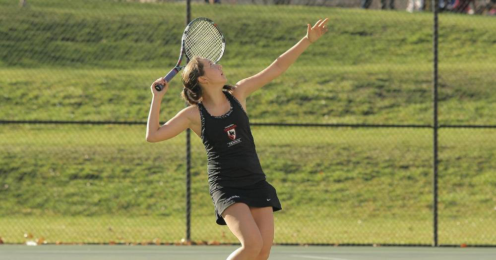 First-year jamie Vizelman winds up in preparation to serve her opponent the ball during a tennis competition. (credit: Courtesy of CMU Athletics)