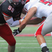 Senior defensive lineman Jack Fagan fights a defender in the loss to Washington University of St. Louis at home.