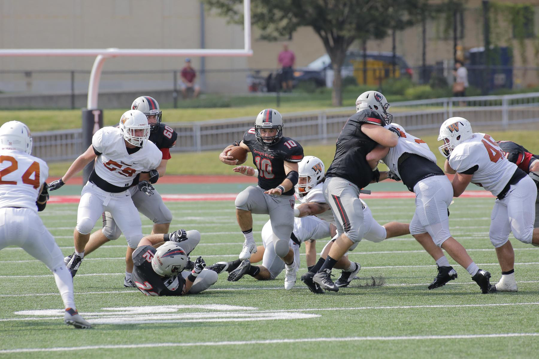 Junior running back Sam Benger bursts through the defense of Waynesburg in the Tartans' victory on Saturday. (credit: Courtesy of CMU Athletics)