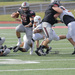 Junior running back Sam Benger bursts through the defense of Waynesburg in the Tartans' victory on Saturday.