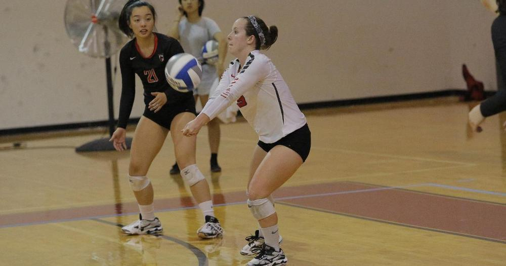 Senior libero Molly Higgins gets in position to hit the ball. Higgins has been a strong defensive player this year. (credit: Courtesy of CMU Athletics)