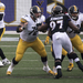 Pittsburgh Steelers quarterback Ben Roethlisberger sets up behind his offensive line to pass against the Ravens.