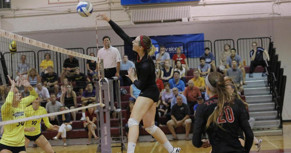 Senior Jackie Gibbons jumps for a ball near the net. Gibbons was a strong force in both matches this weekend. (credit: Courtesy of CMU Athletics)