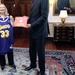 Retired NBA legend Kareem Abdul-Jabbar presents Hillary Clinton with a game jersey bearing his former number.