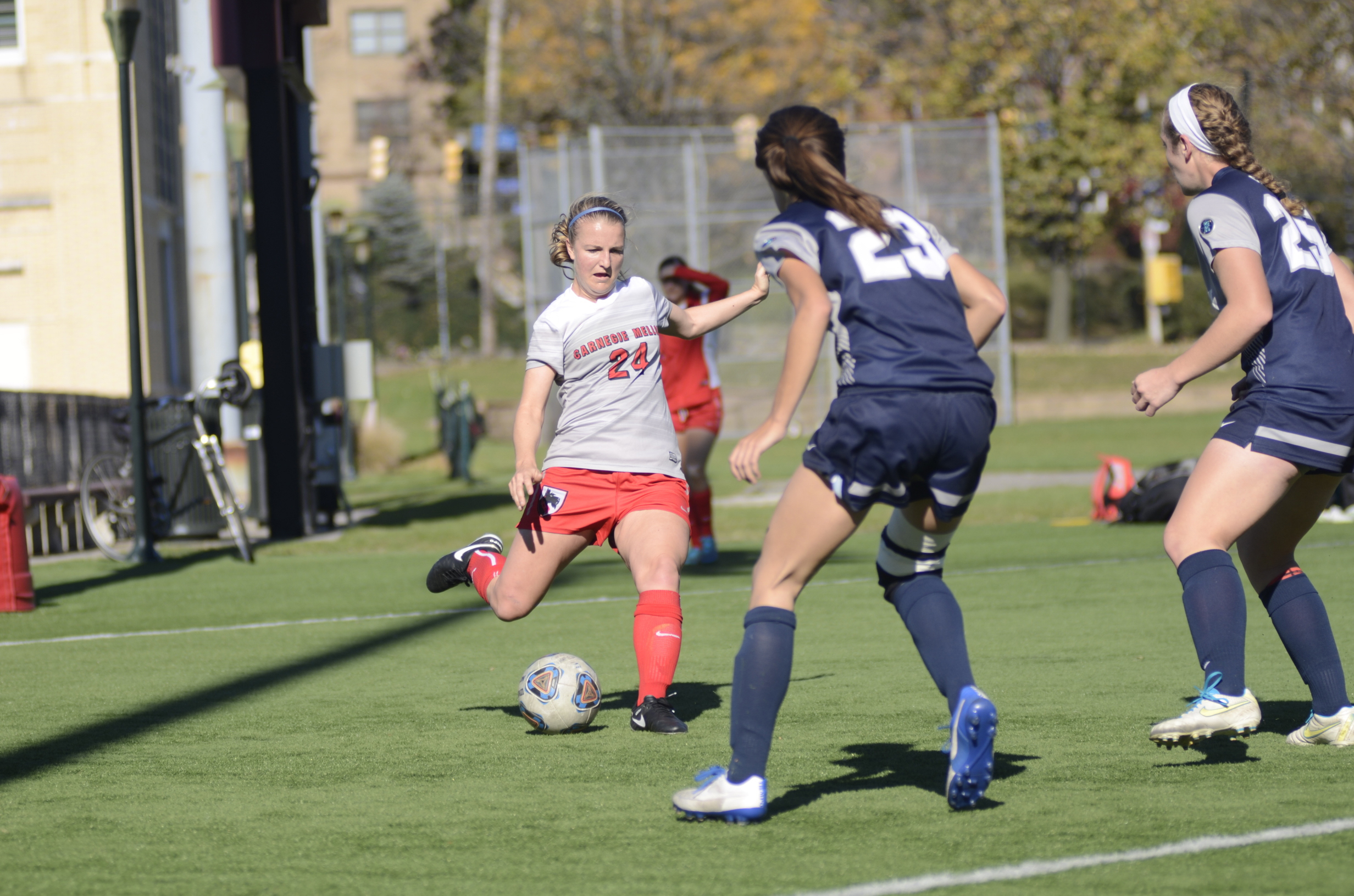 Junior midfielder Morgan Kontor winds up to strike a forward pass through the legs of a defender on Saturday. (credit: Mark Egge/)