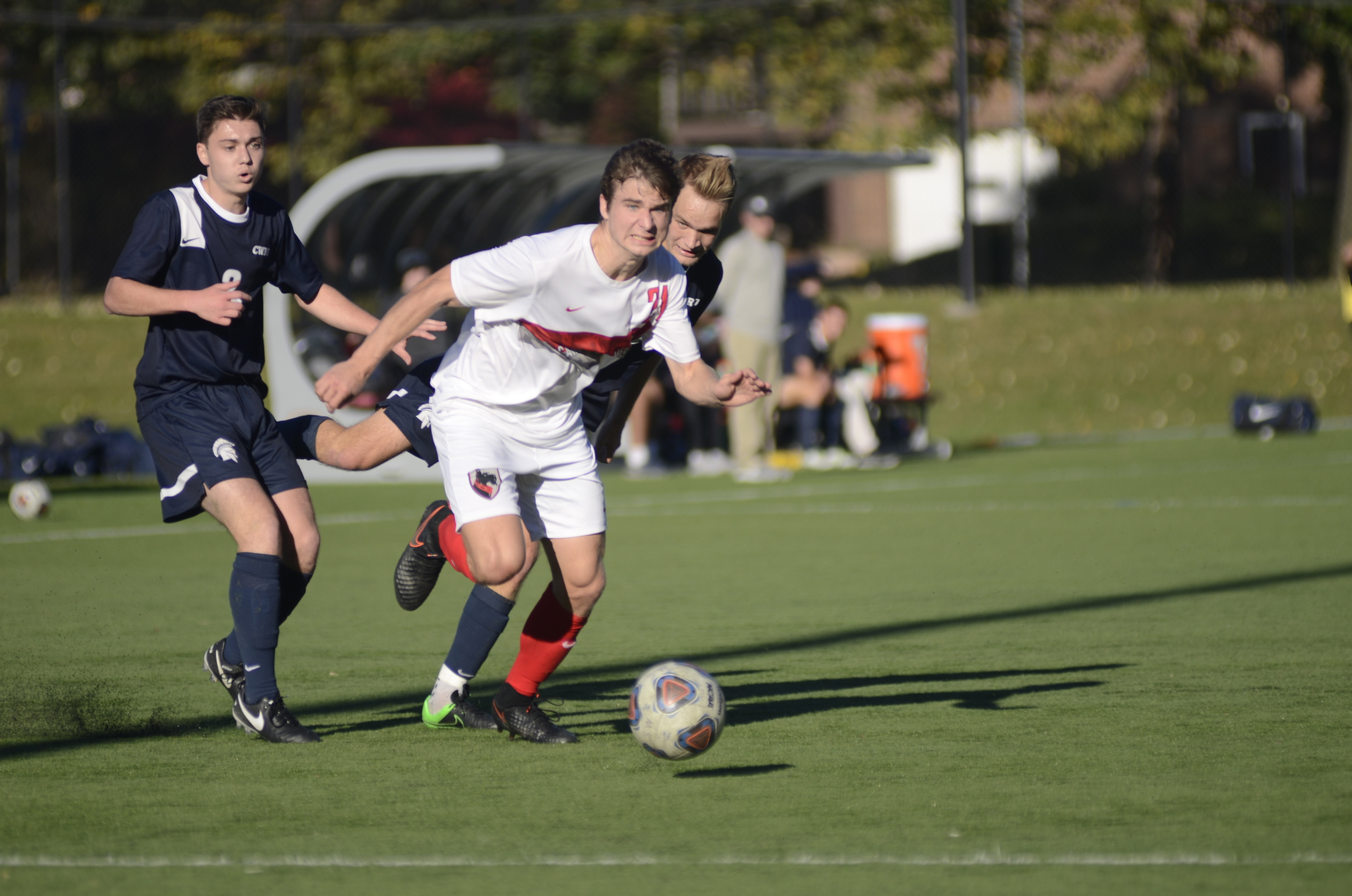 First-year midfielder John Painter fights his way through two defenders against Case Western Reserve University. (credit: Mark Egge/)