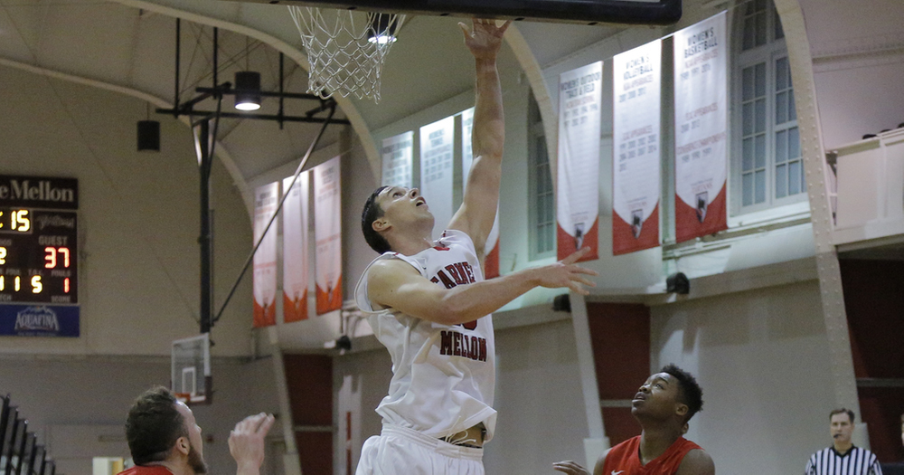 Senior center Chris Shkil gets way up over a defender as he takes it to the rim in the Tartans' victory last week. (credit: Courtesy of CMU Athletics)