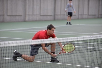 First-year Mike Rozenvasser battles hard in a rally against Oberlin. Rozenvasser has started his career strong. (credit: CMU Athletics)