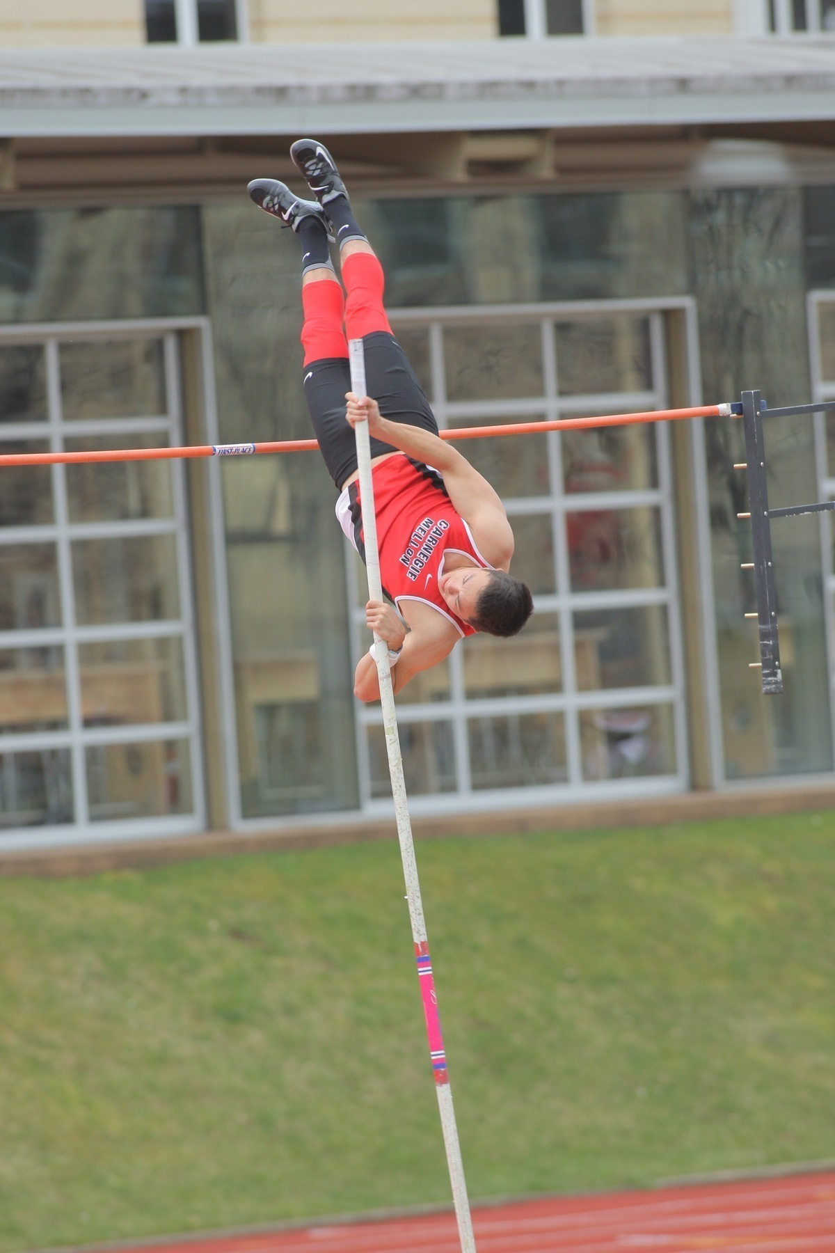 Junior Thomas Mansfield pole vaults to a 4.20 meter mark, helping the Tartans earn first place on Saturday. (credit: CMU Athletics)