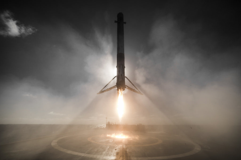 A Falcon 9 rocket takes off at sea. Commercial space companies promote innovation and competition. (credit: Courtesy of SpaceX, via Flickr Creative Commons)