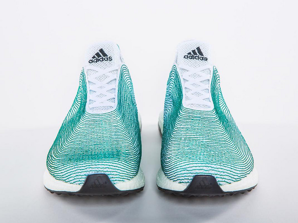 Top and frontal views of Adidas' new shoe made from recycled ocean waste and illegally disposed  shing nets. (credit: Courtesy of designmilk, via Flickr Creative Commons)