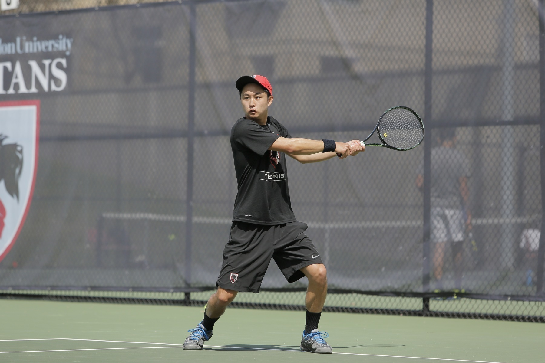 Senior Kenny Zheng's court efforts were not enough to triumph over Chicago in the third place match. (credit: CMU Athletics)