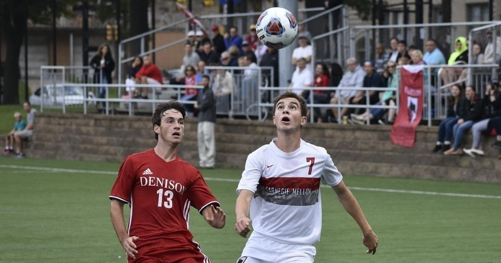 Junior defender Philip Petrakian keeps the ball away from Denison's feet, aiding junior goalkeeper Alec Lam. (credit: Courtesy of CMU Athletics)