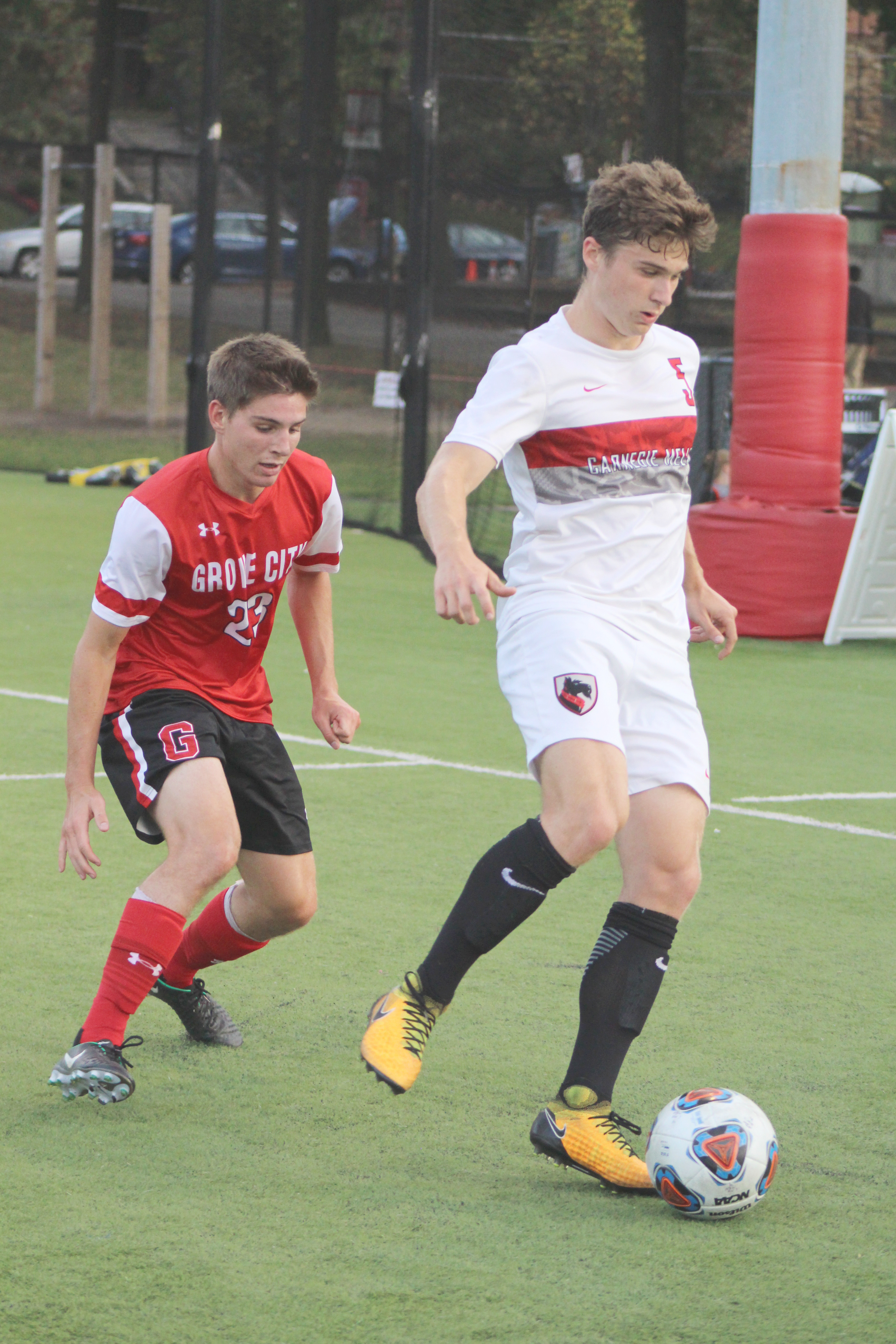 Sophomore midfielder Jack Painter passes through a Grove City player. (credit: Jeanette De La Torre- Duran/ Junior Photographer)