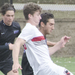 The men's soccer team pressures New York University's defense, keeping the ball away from their side.
