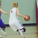 Sophomore Katharine Higgins drives to the basket the first loss of the season against Capital University.