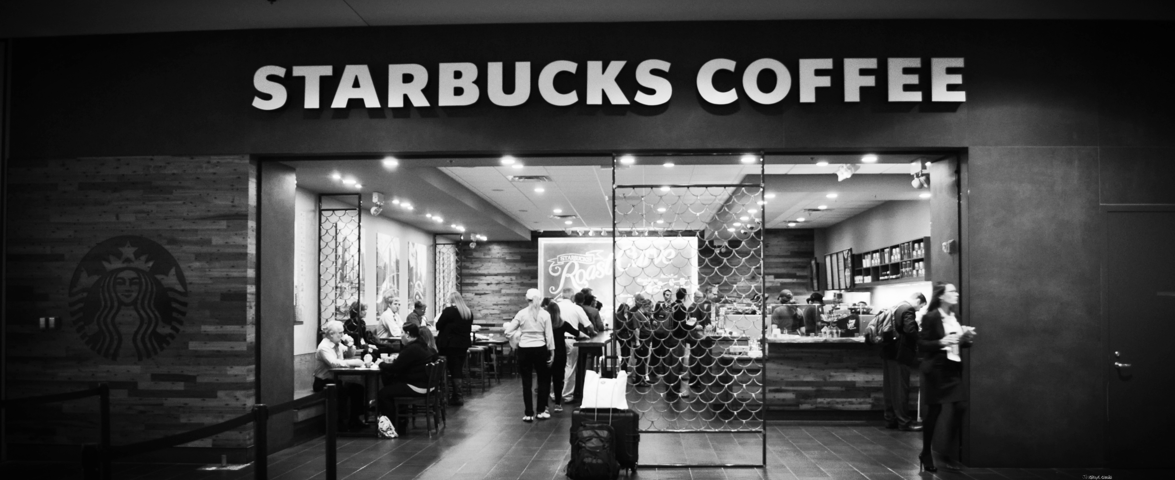 Starbucks will close 8,000 of its stores to implement racial bias training for its employees to improve customer experience. (credit: Courtesy of Joseph Cerulli via Flickr Wikimedia)