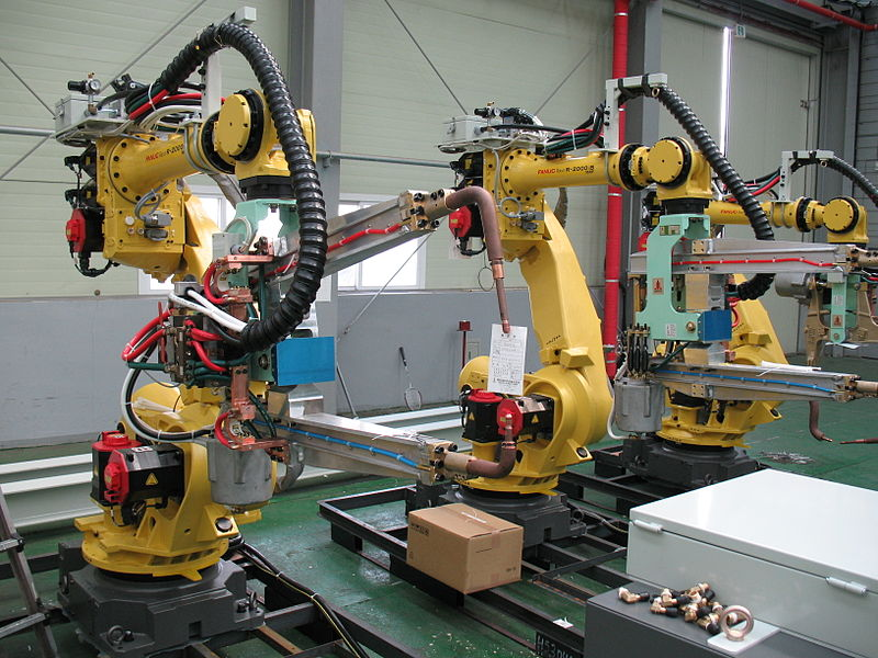 Industrial robots like this one are used in manufacturing to increase efficiency and yield. A joint study from the Department of Economics at Uppsala University and the London School of Economics has found that using industrial robots may actually increase wages for humans. (credit: Mixabest via Wikimedia Commons)