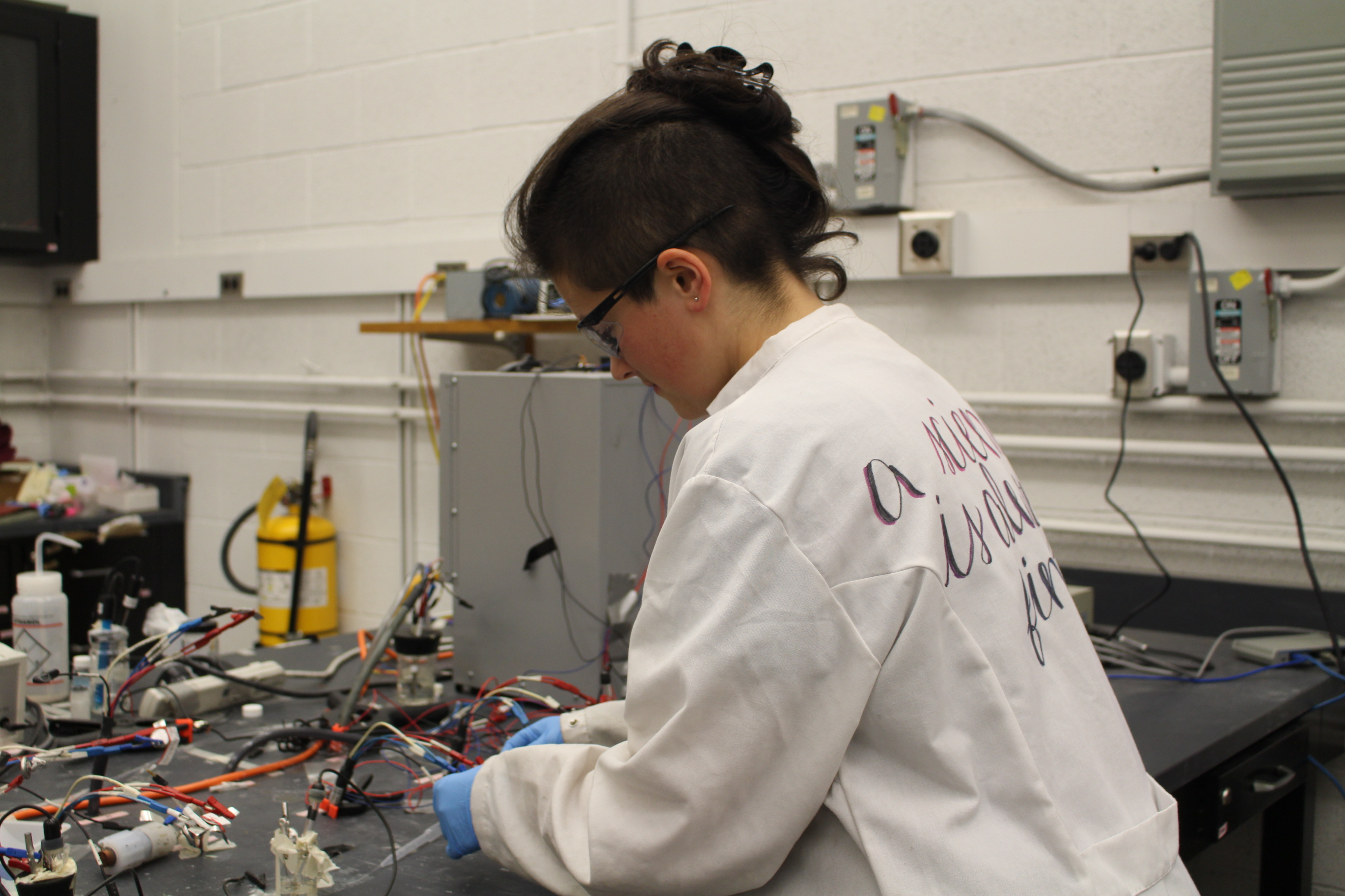 """""""I'm socialized female, I'm read female most of the time, and that really affects my experience in STEM,"""" says Sarah Frisco, a PhD student in materials science who researches lithium batteries. """"What's most important to me is getting my science done."""" (credit: Lisa Qian/Photo Editor)"""