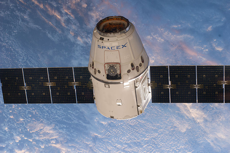 SpaceX's Dragon spacecraft on a resupply mission to the International Space Station. The same hardware could be used to carry astronauts to the moon. (credit: Courtesy of NASA via Wikimedia Commons)