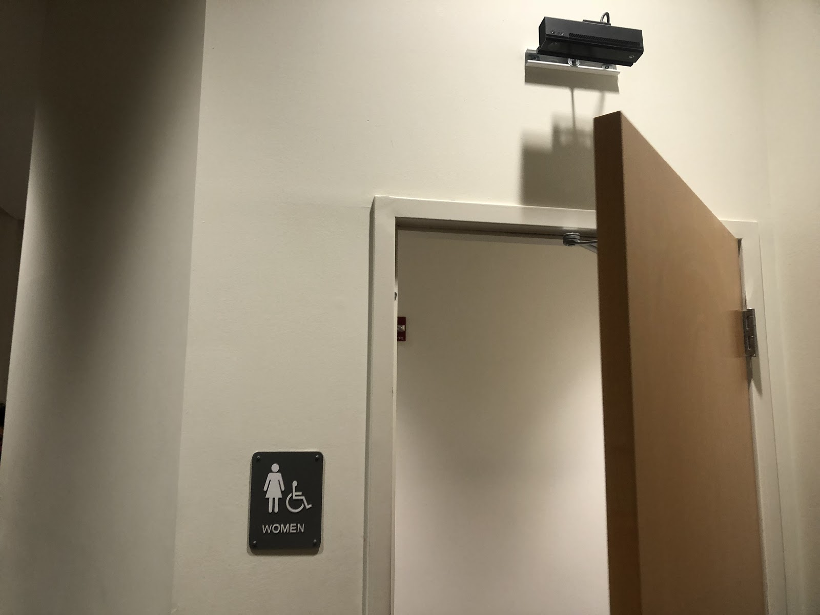 A Microsoft Kinect sensor is seen mounted above a women's bathroom in the CUC. The sensors are part of an ongoing research project.