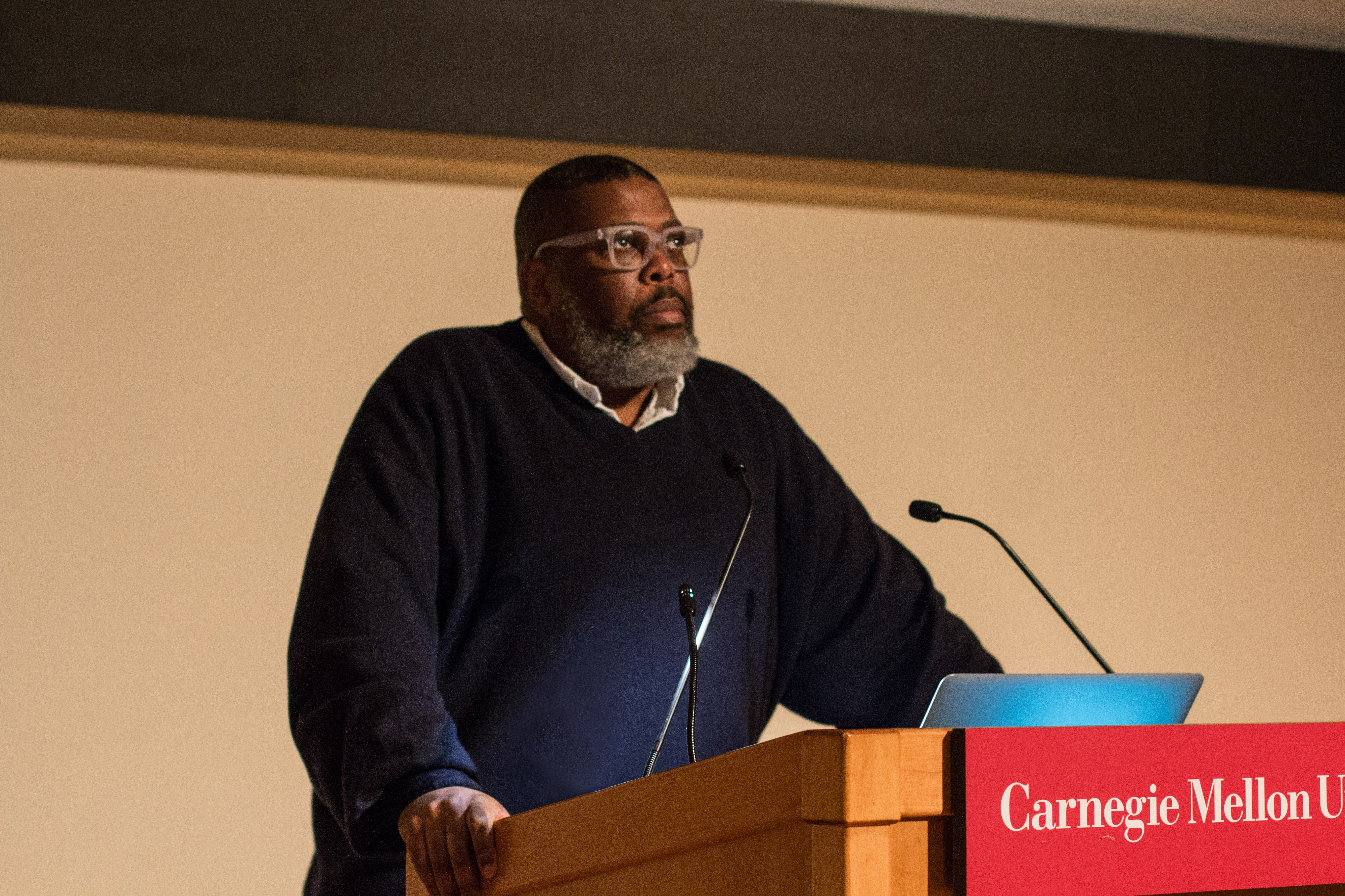 """Hilton Als, Columbia professor, New Yorker staffwriter, and award-winning critic, pictured during his lecture """"Just Us: Considering Art in the Age of 'Wokeness,"""" which filled McConomy Auditorium Feb. 18. (credit: Courtesy of Jacquelyn Johnson, School of Art)"""
